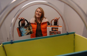 Regina pictured with some of her book purses.